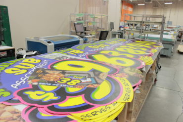 large format signage being produced in the Alexander's warehouse