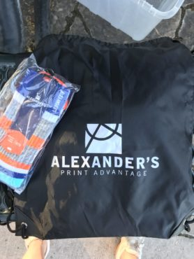 Alexander's branded drawstring bag and socks at the golf tournament